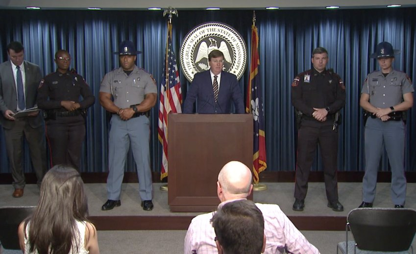 Gov. Tate Reeves, flanked by state law enforcement officials, unveils a plan to help reduce crime in Jackson last week.