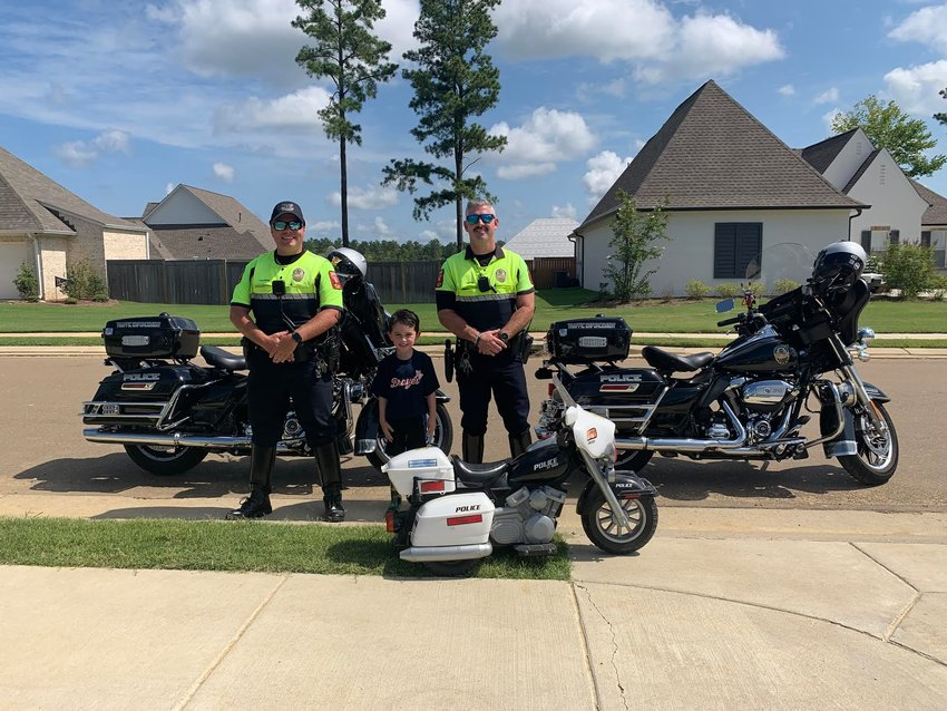 Madison motorcycle patrol officers John Cannon and William Davis surprised Easton Hardin, 4, outside his home for a play date earlier this month. Easton wants to be a police officer — preferably a motorcyle patrol officer — when he grows up.