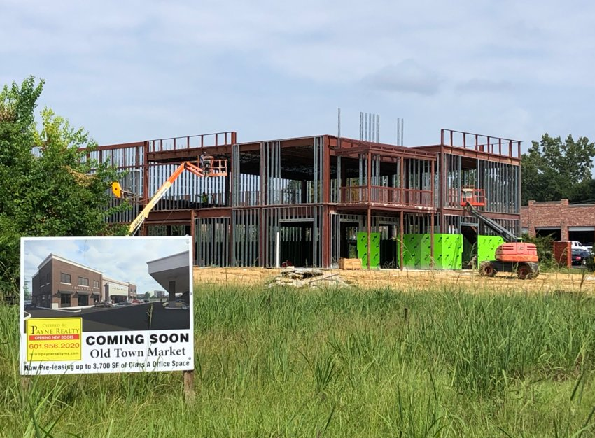 Construction crews work on the site of the new Old Town Market in Ridgeland.