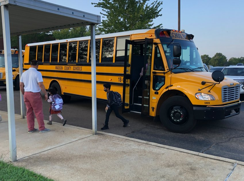 Students exit a bus at Madison Avenue Elementary School Wednesday morning. Currently, the Madison County School District is experiencing a bus driver shortage and this has impacted routes and pickup/dropoff times.