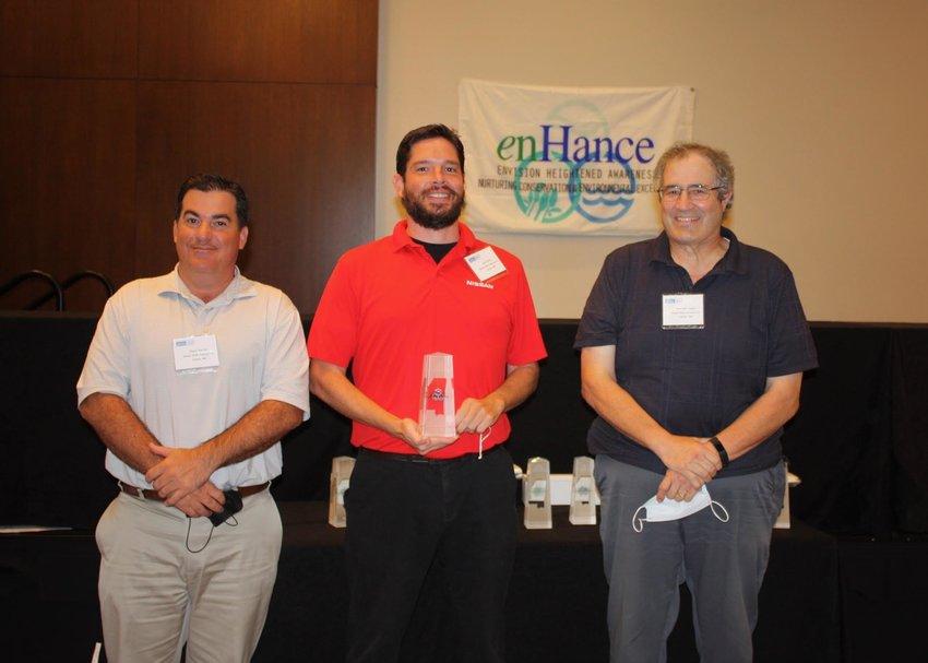 Nissan employees accepting the award are, from left, Shane Gorman, Jason Redd and Brett Rasmussen.