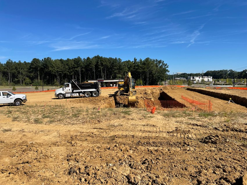 Workers move dirt Friday on the grounds of what will be a new Chick-fil-A on the Highland Colony Parkway across from the Costco Wholesale in Ridgeland.