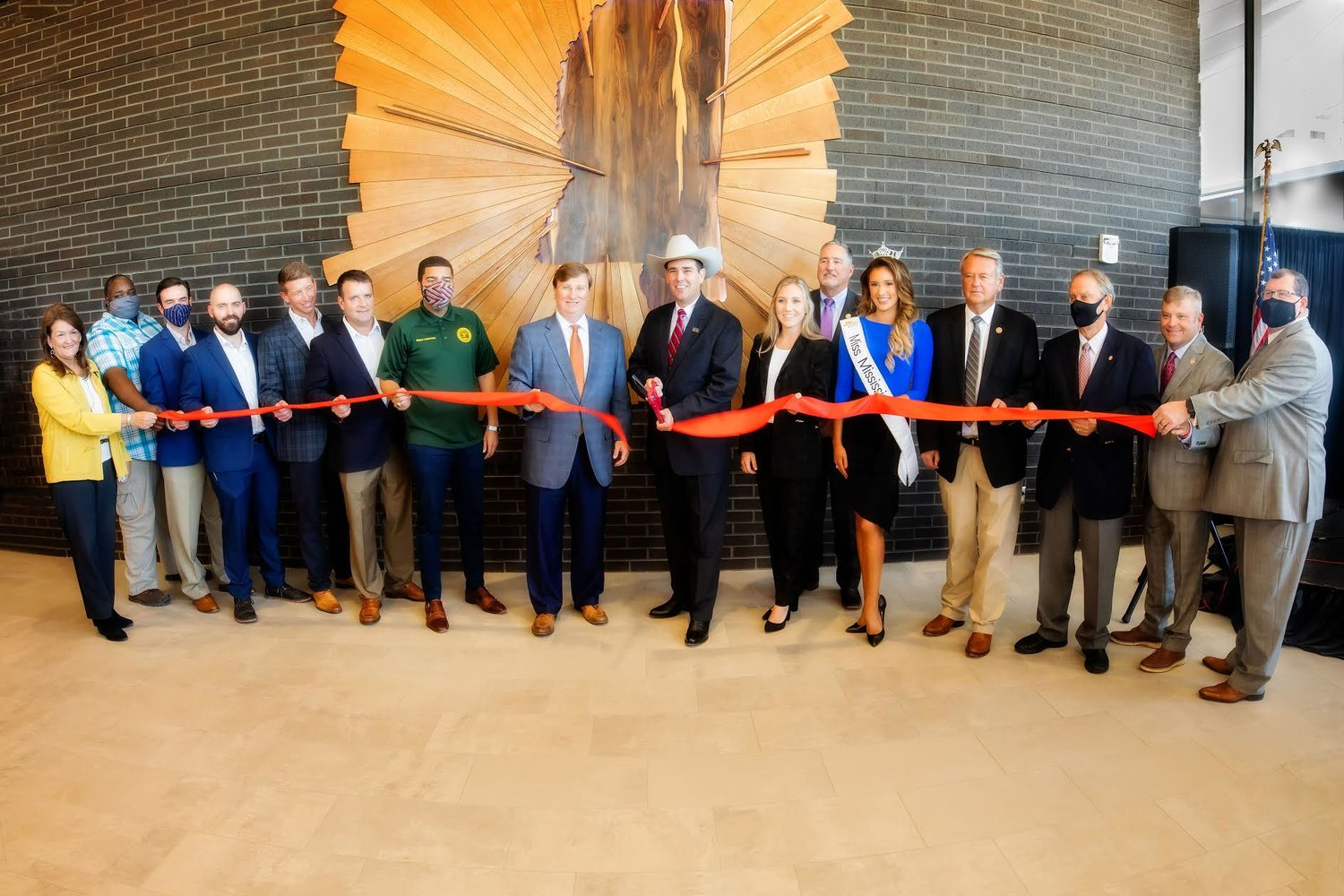 Commissioner Andy Gipson officially opens the new Mississippi Trade Mart on the State Fairgrounds with a building dedication and ceremonial ribbon cutting. Pictured left to right: Janet Trotter, Committee Assistant for the Senate Finance Committee; Mike Jenkins, Project Manager with Fountain Construction; Jack Allin, Principal Architect with Wier Boerner Allin Architecture; Sully Clemmer, Project Architect with Wier Boerner Allin Architecture; Jamie Wier, Principal Architect with Wier Boerner Allin Architecture; Michael Boerner, Principal Architect with Wier Boerner Allin Architecture; Jackson Mayor Chokwe Antar Lumumba; Mississippi Governor Tate Reeves; Commissioner Andy Gipson; Anna-Michael Smith; Vince Mangold, Mississippi House of Representatives Agriculture Committee Vice-Chairman; Miss Mississippi Mary Margaret Hyer; Bill Pigott, Mississippi House of Representatives Agriculture Chairman; Mike Chaney, Mississippi Commissioner of Insurance; Mississippi Representative Bubba Carpenter; and Dane Maxwell, Mississippi Public Service Commissioner.