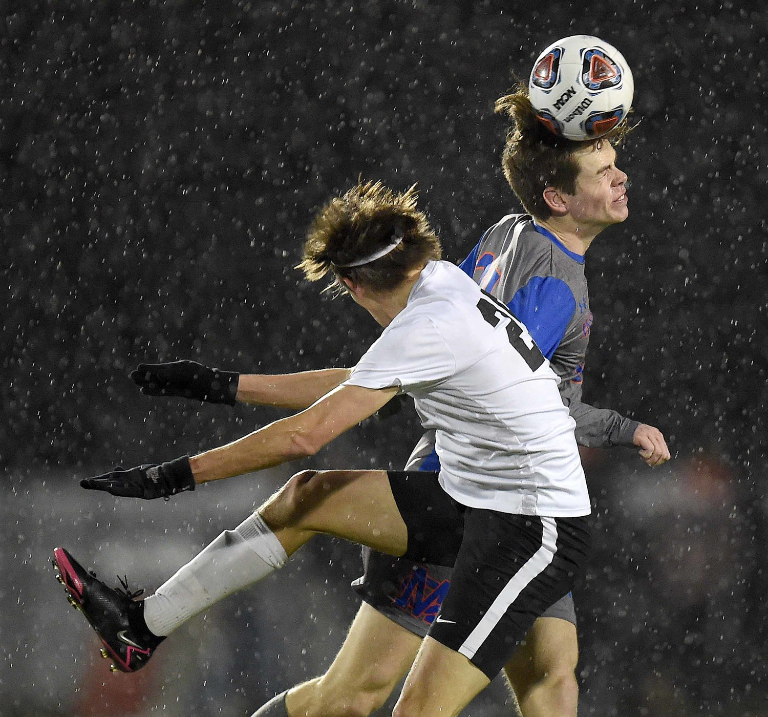 Madison Central's Will Scoggins heads the ball away from Brandon's Layton Levingston (29) in the MHSAA Class 6A State Soccer Championship on Saturday, February 6, 2021, at Clinton High School in Clinton, Miss.
