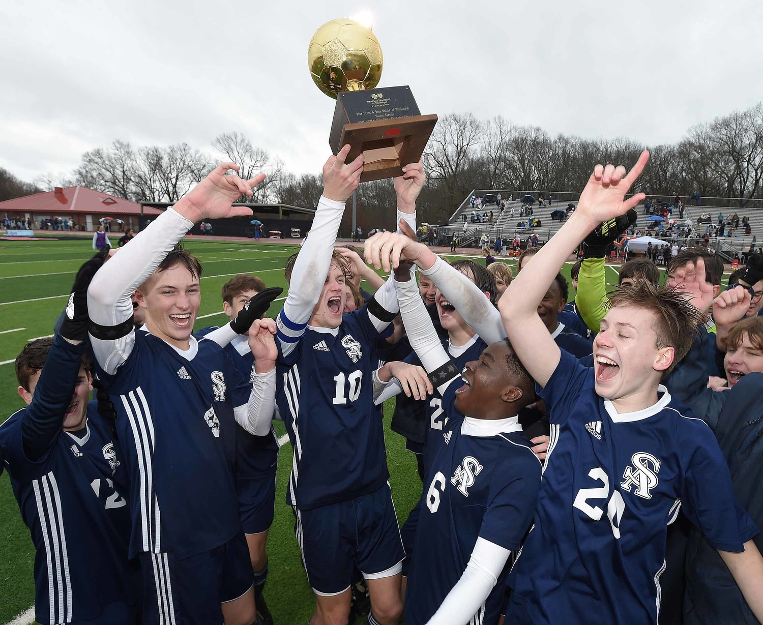 The St. Andrew's Saints celebrate after beating Clarkdale in the MHSAA Class I State Soccer Championships on Saturday, February 6, 2021, at Clinton High School in Clinton, Miss. Pictured, left to right, are Jack Crawford, Hudson Bataille, Rolen Fanning, Jackson Bataille, Dami Oluwatade, Merritt DeVoss, and Nico Buford.