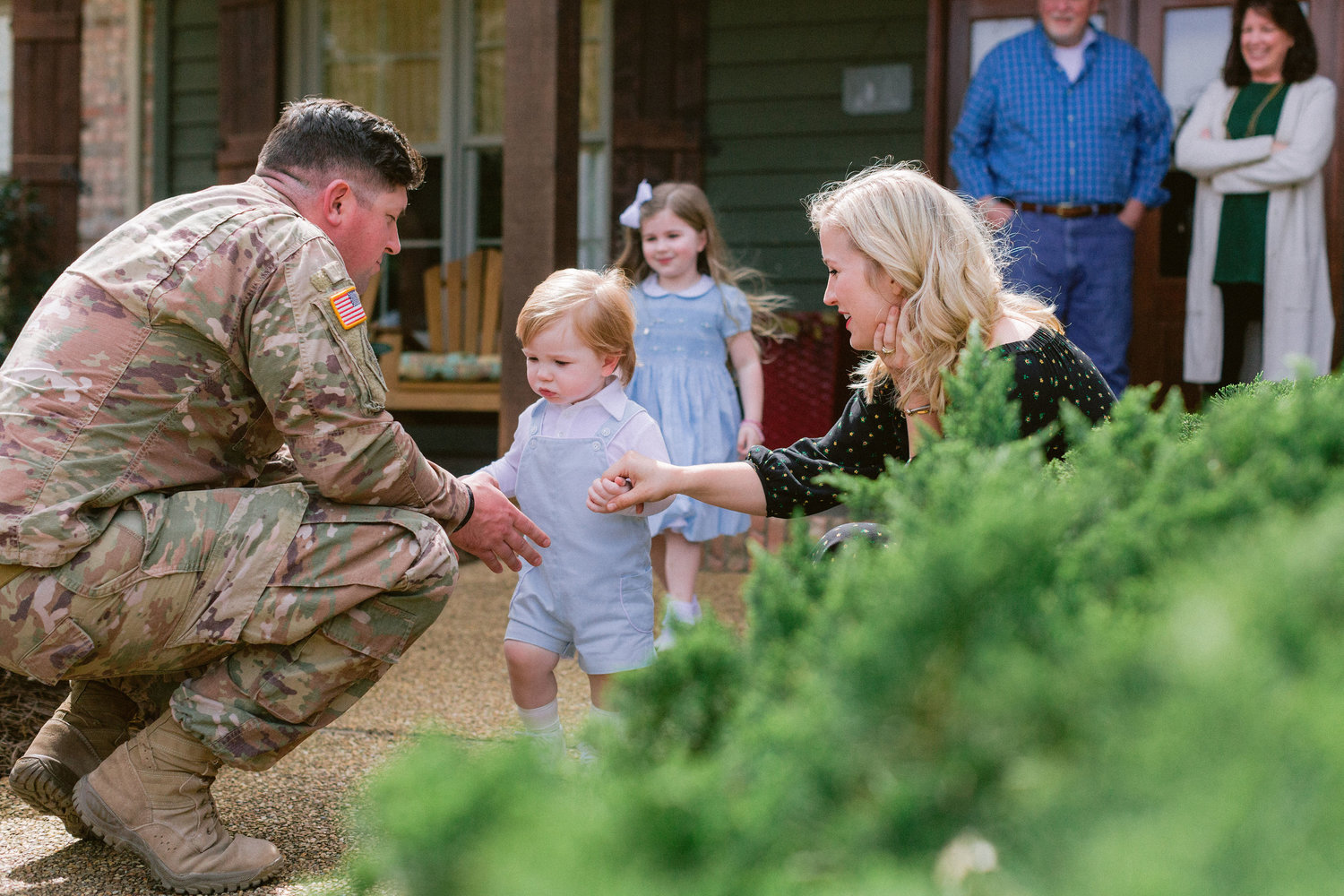 Harper Solop, left, prepares to pick up son, Wilder, after a 13-month deployment in the Middle East. Looking on are wife Sarah Beth Solop and daughter Ava. A short that will be filmed in Canton this month will focus on Sarah Beth's time as a military wife.