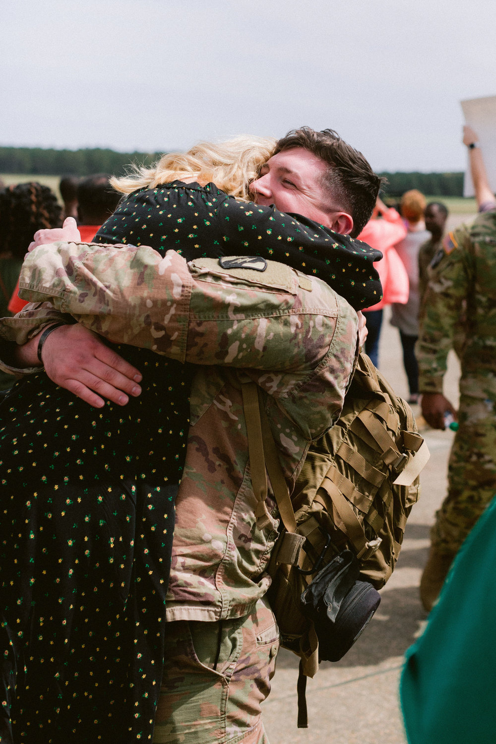 Harper and Sarah Beth Solop hug at Thompson Field near Flowood in March 2018 after Harper returned from a 13-month deployment in the Middle East.