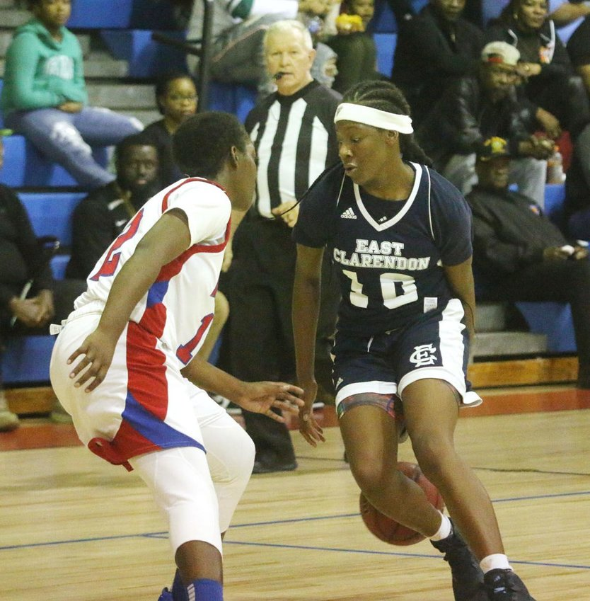 Talaysia Cooper goes behind the back with the ball. Cooper lead her lady Wolverines to a season finale win.