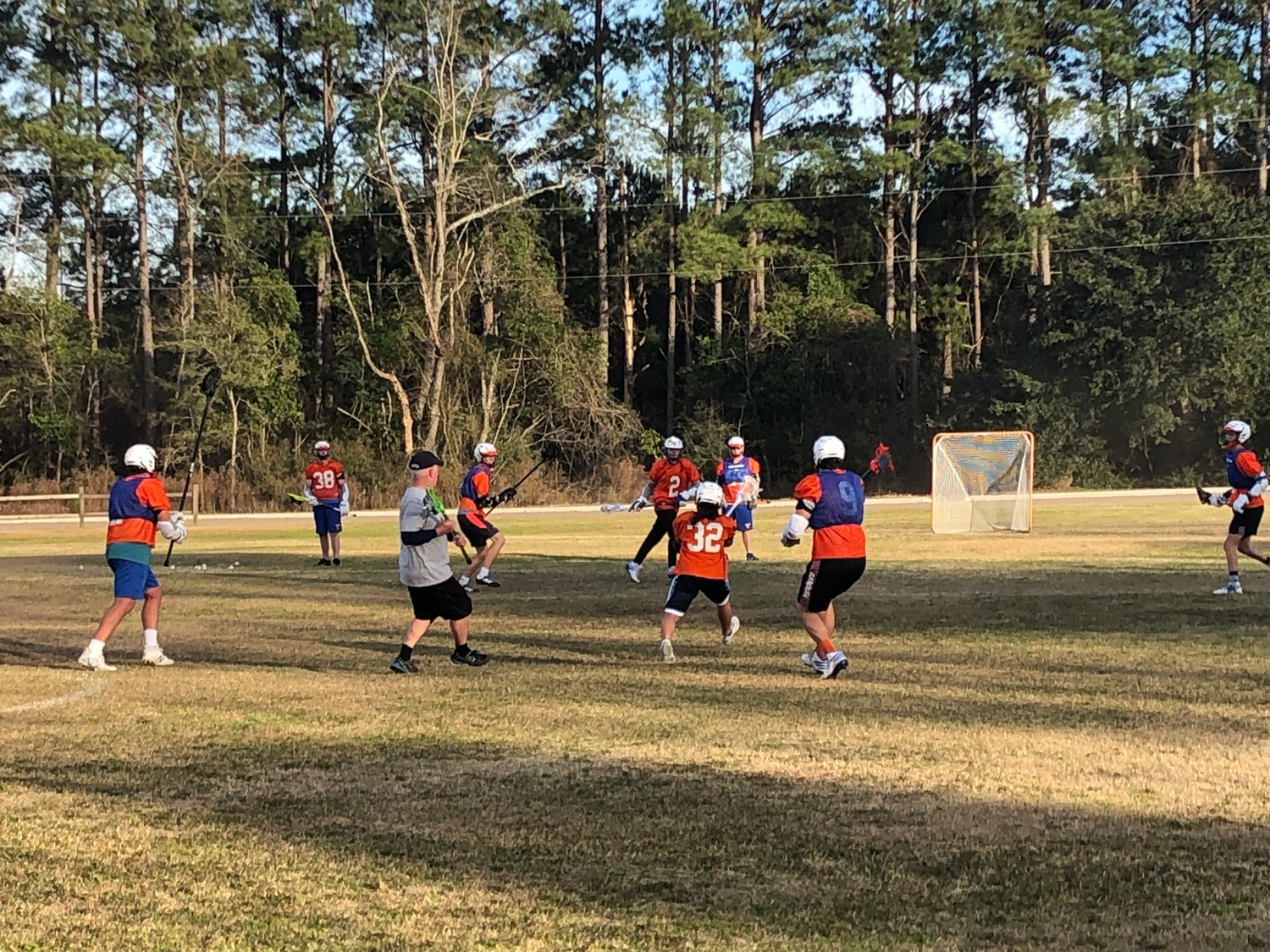 Laurence Manning Academy athletes practice for their first lacrosse match.