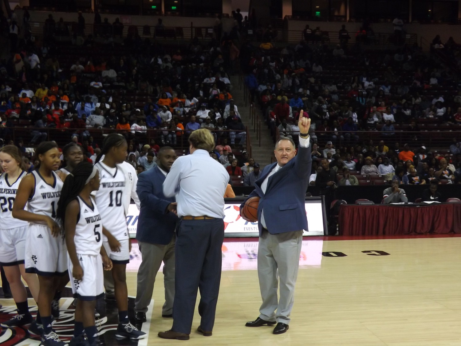 Coach Mike Lowder walked onto court and points to the fans from Turbeville, showing his appreciation.