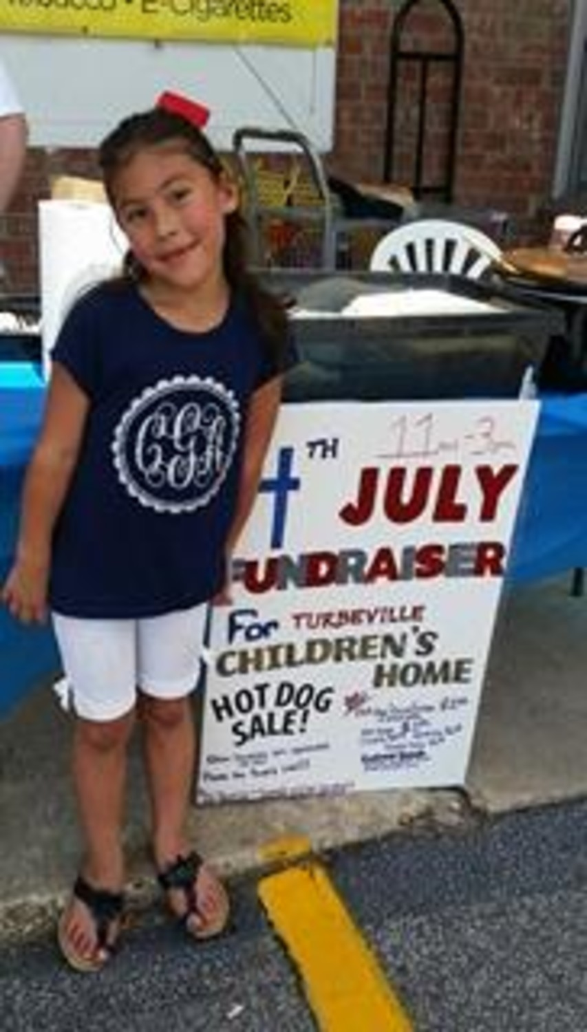 Camilla Garcia, daughter of one of the Turbeville Children's Home employees, was on hand July 4 for the home's hot dog and bake sale at the Turbeville Dollar General.