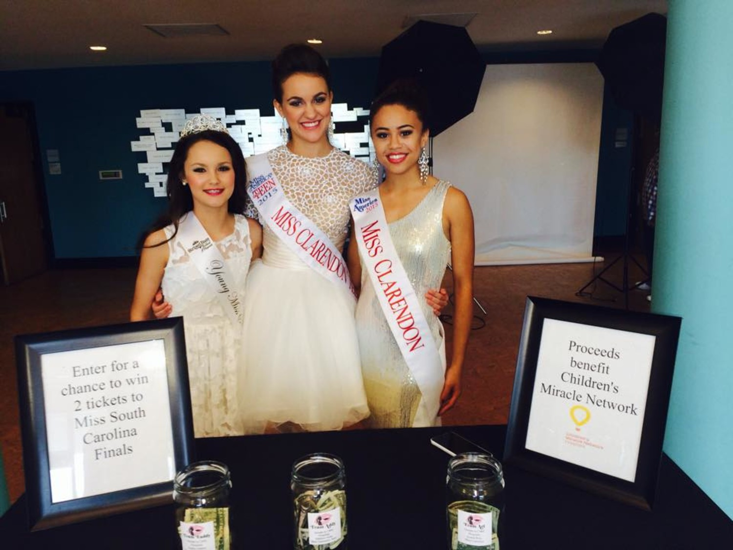 ERICKA SEXTON FLOYD / SPECIAL TO THE TIMESFrom left, Miss Clarendon Pre-teen Eaddy Osteen, Miss Clarendon Teen Addison Hicks and Miss Clarendon Ariana Ruiz raised money Saturday during the 2015 Miss Striped Bass Festival Pageant at Weldon Auditorium for the 2nd annual Kiss My Striped Bass fundraiser for the Children's Miracle Network hospitals. The team to get the least donations will have to kiss a fish Friday during opening ceremonies for the 36th annual Striped Bass Festival.