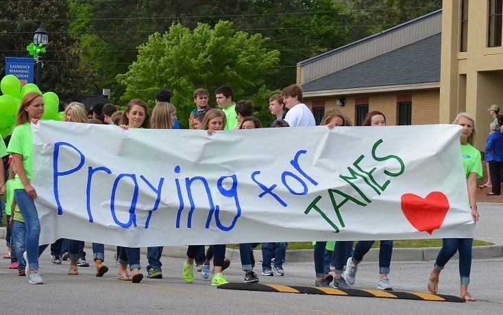 LMA Students march with a banner during the 