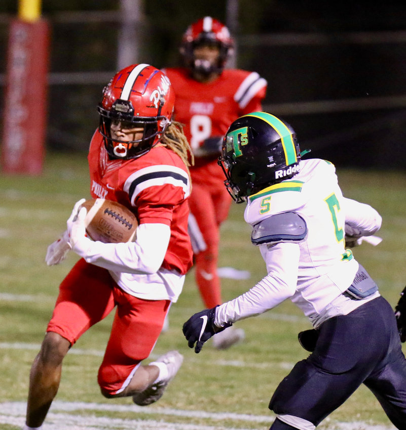 Philadelphia's Dedrick McWilliams (5) finds a hole to pick up some yards in the Tornadoes loss to Taylorsville Friday night.