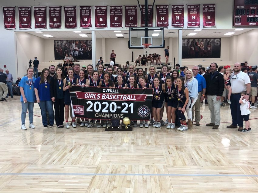 The Leake Academy Rebelettes celebrate winning the 2020-2021 Overall Girls Basketball Tournament.