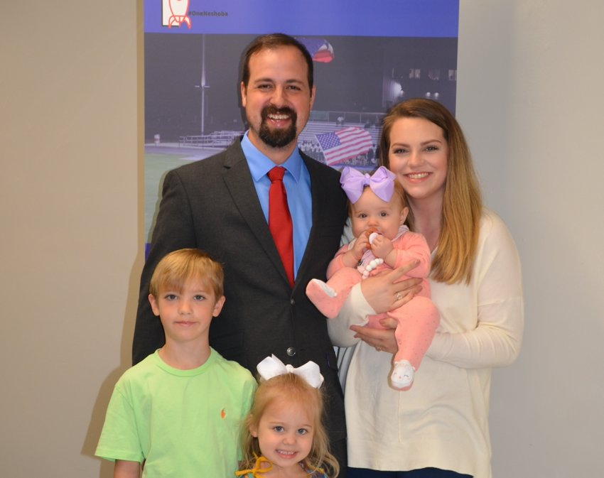 Jacob Drury was named the new Neshoba Central Middle School principal Tuesday morning. He introduced his wife, Courtney, and three children, Reiney, Aiden and Kinsley, to the School Board. Not pictured is daughter, Ashtyn.