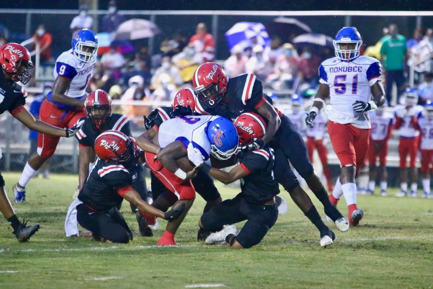 Philadelphia's Kornelious Triplett (24) breaks a tackle for a Tornadoes first down. The Philadelphia High School Tornado football team will forfeit its next two games after numerous players have come in close contact with a coach who tested positive for the coronavirus.