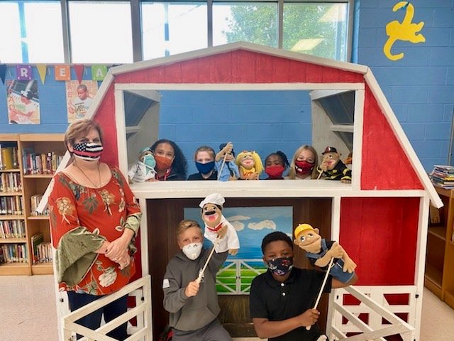 Rachel Kiepe is pictured with her students at the puppet barn in the Philadelphia Elementary School Library. Joining Kiepe are, from left, Katilynn Gray, Conner Robertson, Carly Beth Richardson, Macie Spurlock, Khordez Finley and Carlisle Ray.