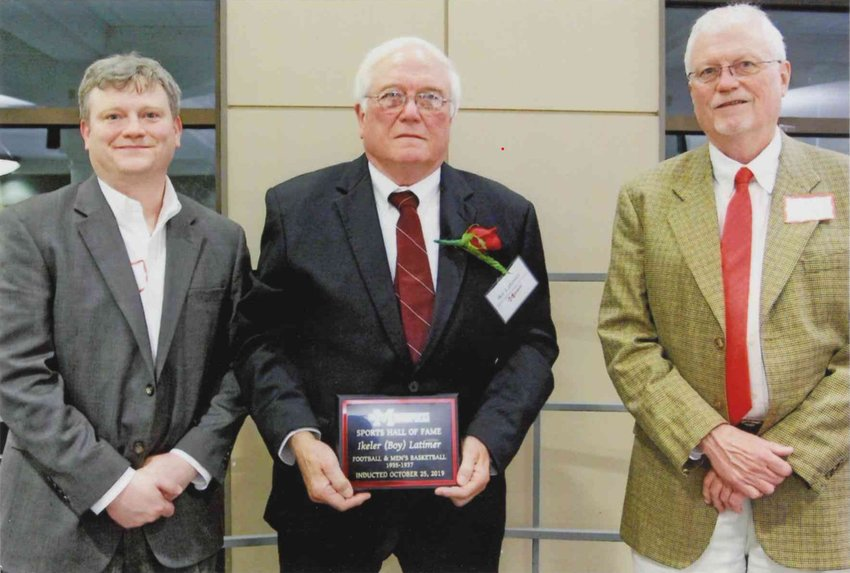 """Mr. Ike L. Latimer, the son of the late Ikeler M. """"Boy"""" Latimer, is flanked by the senior's grandson Spence I. Latimer, left, and brother William L. Latimer, right. This photo was taken following EMCC's 2019 Sports Hall of Fame induction banquet in which the late Mr. Ikeler M. """"Boy"""" Latimer was posthumously inducted."""