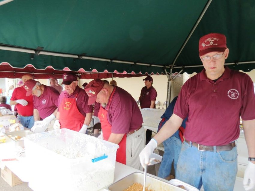The Neshoba County Shrine Club will hold its annual BBQ chicken plate sale on Nov. 7. Pictured left to right are: Richard Whitehead, Mitchell McDonald, Grover Vining, John Stewart (background) Dean Bivatea and Robert Hodgins.
