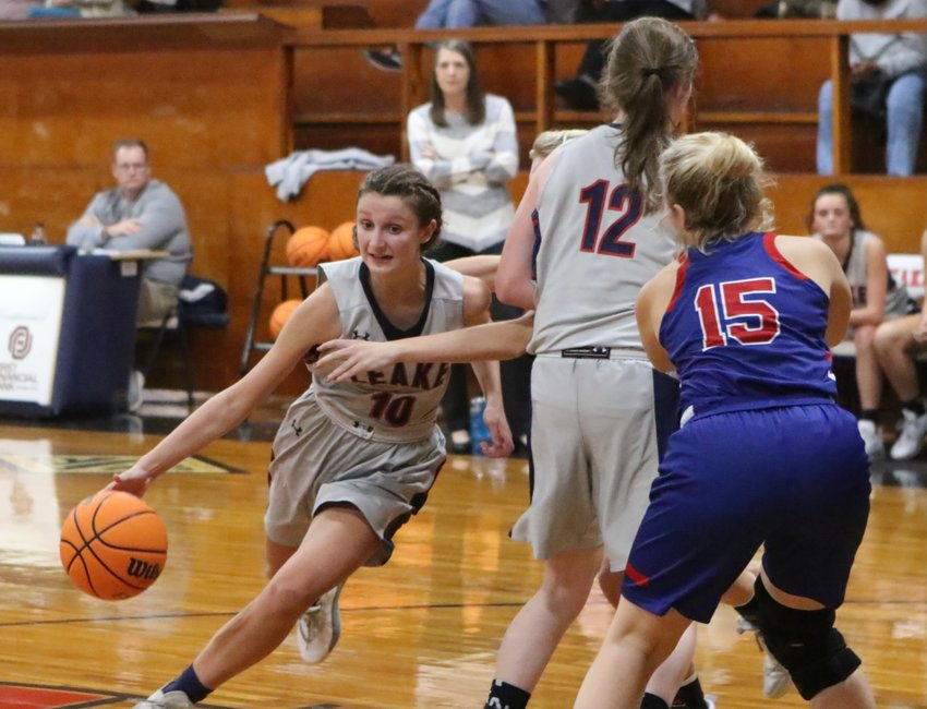 Leake Academy's Miriam Prince of Philadelphia drives around a Simpson Academy defender while Emri Warren sets a pick.