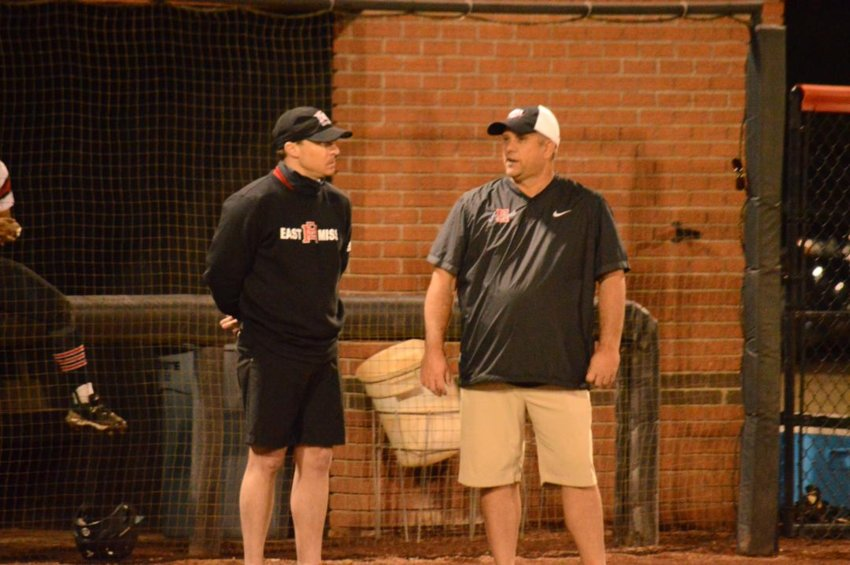 EMCC coach Austin McNair, left, talks with Holmes Community College coach Trae Embry.
