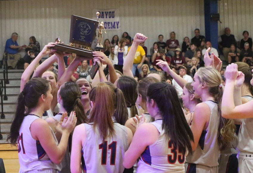 The Leake Academy girls celebrate winning the Class AAAA state championship on Saturday at Hillcrest Christian.