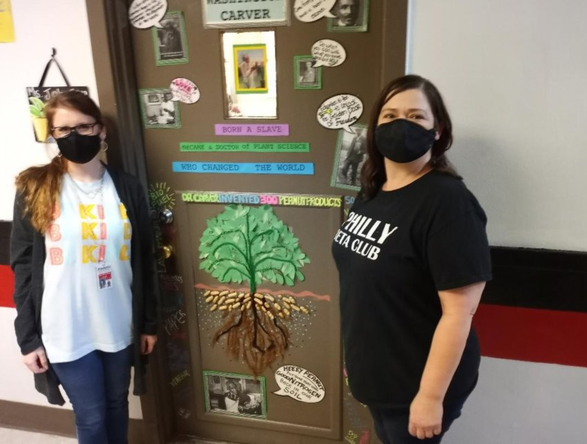 The first-period classes of Mary Kate Collins Hollingsworth, left, and Jennifer Johnson tied for first in Philadelphia High School's Civil Rights door decoration contest.