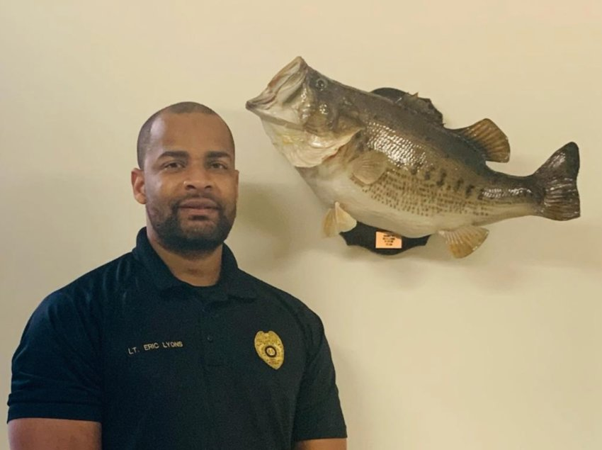 Police Chief Eric Lyons shown with the 12-pound bass he caught at Neshoba Lake that was a record.