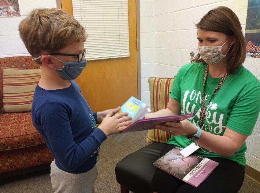 Philadelphia Elementary School's Amanda Hattaway works with second grader Sam Ray who is the leading AR points reader in his class.
