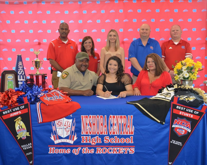 At her signing ceremony are, front row, from left, her dad, Vince Carter; Lexxi Carter; and her mom, Jeannie Smith; second row, from left, Assistant Principal, LaShon Horne; Assistant Principal, Dana McLain; Cheer Coach, Nikki Morrow; Principal Jason Gentry; and Assistant Principal, Brent Pouncey.