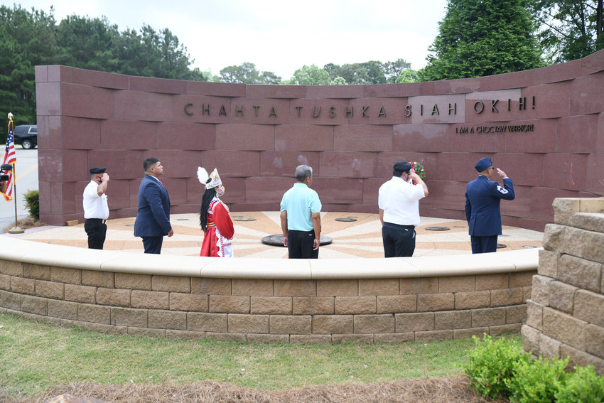 Members of the Choctaw Veterans Color Guard, Tribal Chief Cyrus Ben, 2019-2021 Choctaw Princess Elisah Jimmie, Choctaw Veteran Affairs Director Sammie Wilson, and Chief Master Seargent Ricky Alex gather around the center of the Veterans Memorial to lay the wreath in honor of Memorial Day.