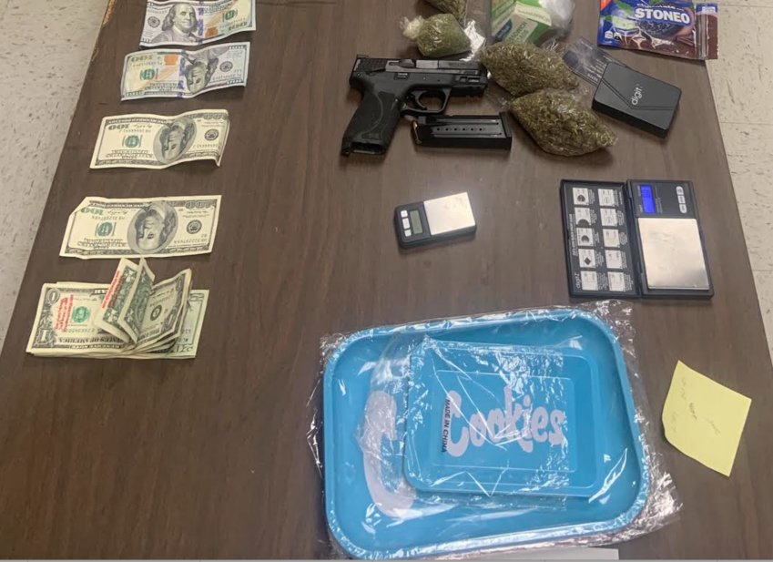 A man is in custody after he was caught with drugs, cash, a firearm, and other drug paraphernalia in a traffic stop Monday on Highway 482.