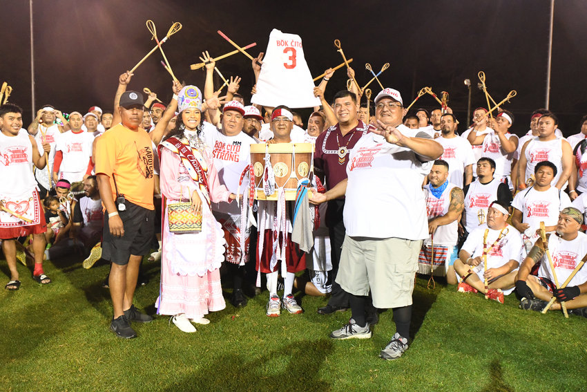 Bok Cito celebrates after winning the World Series of Stickball. Newly-crowned Choctaw Princess Shemah Crosby and Tribal Chief Cyrus Ben presented the trophy.