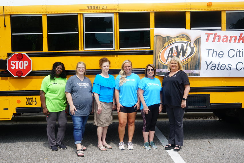 Volunteers at the event include, from left, Angela Tatum of WAITR; Channing Peebles of The Citizens Bank; Sandra Curtis of The Citizens Bank; Destynie Phillips of United Way; Tammy Caldwell of United Way; and Kim Posey of Citizens National Bank.