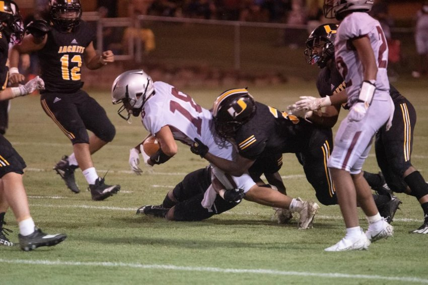 Choctaw Central's Braylon McMillian tries to pick up yards against Union.