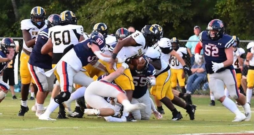 The Leake Academy defense wraps up Union's Kenyon Clay in a 48-13 win.