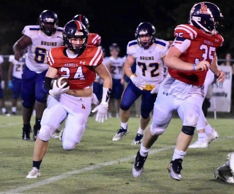 Leake Academy running back Whitt Welch runs for the end zone while Gavin White leads the way Friday against Madison St. Joseph.