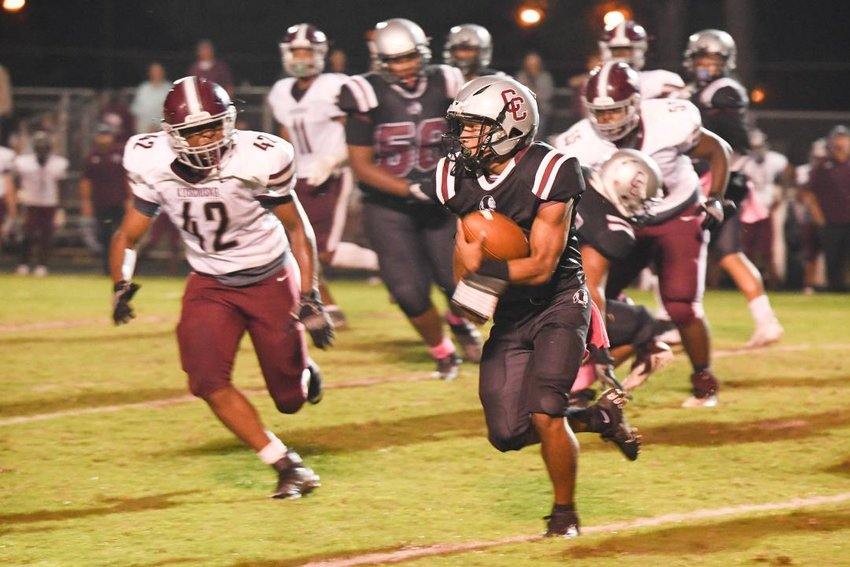 Jeriah Jimmie runs for daylight in Choctaw Central's game with Kosciusko Friday night. The Whippets won the game, 35-20.