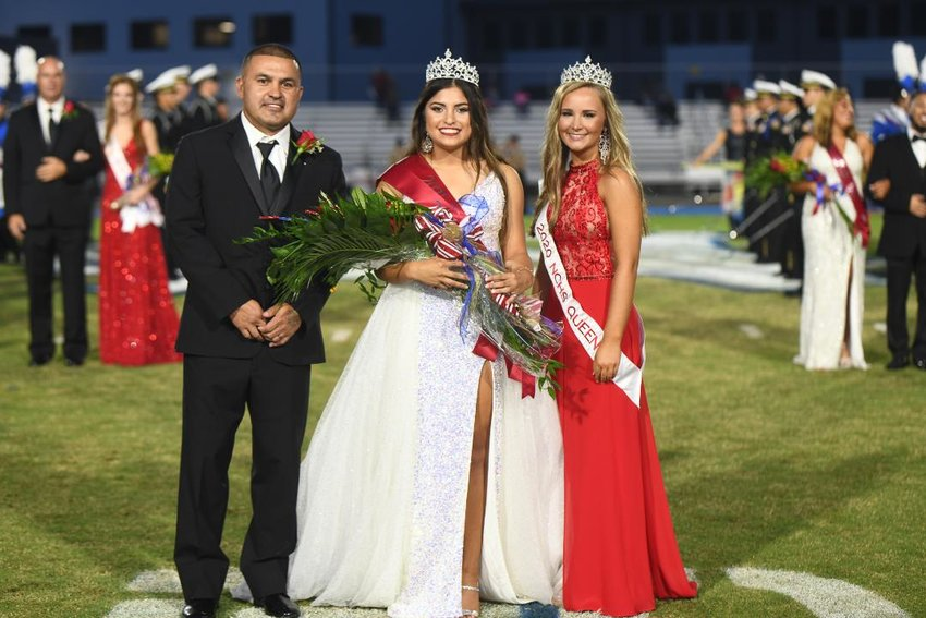Tenly Grisham, center, was crowned Neshoba Central High School's homecoming queen Oct. 1. She is pictured with her father, Jason Grisham, left, and Neshoba Central's 2020 homecoming queen, Anna Cumberland.