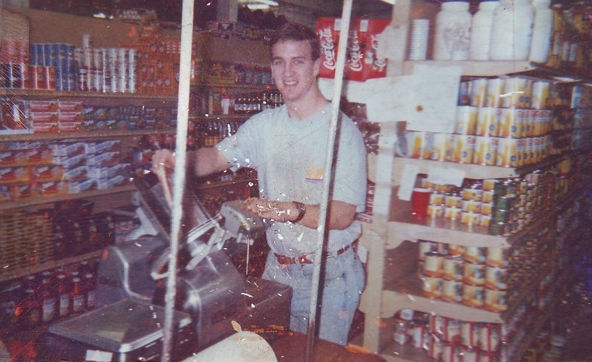 Peyton Manning slicing bacon at the family store as a youth.