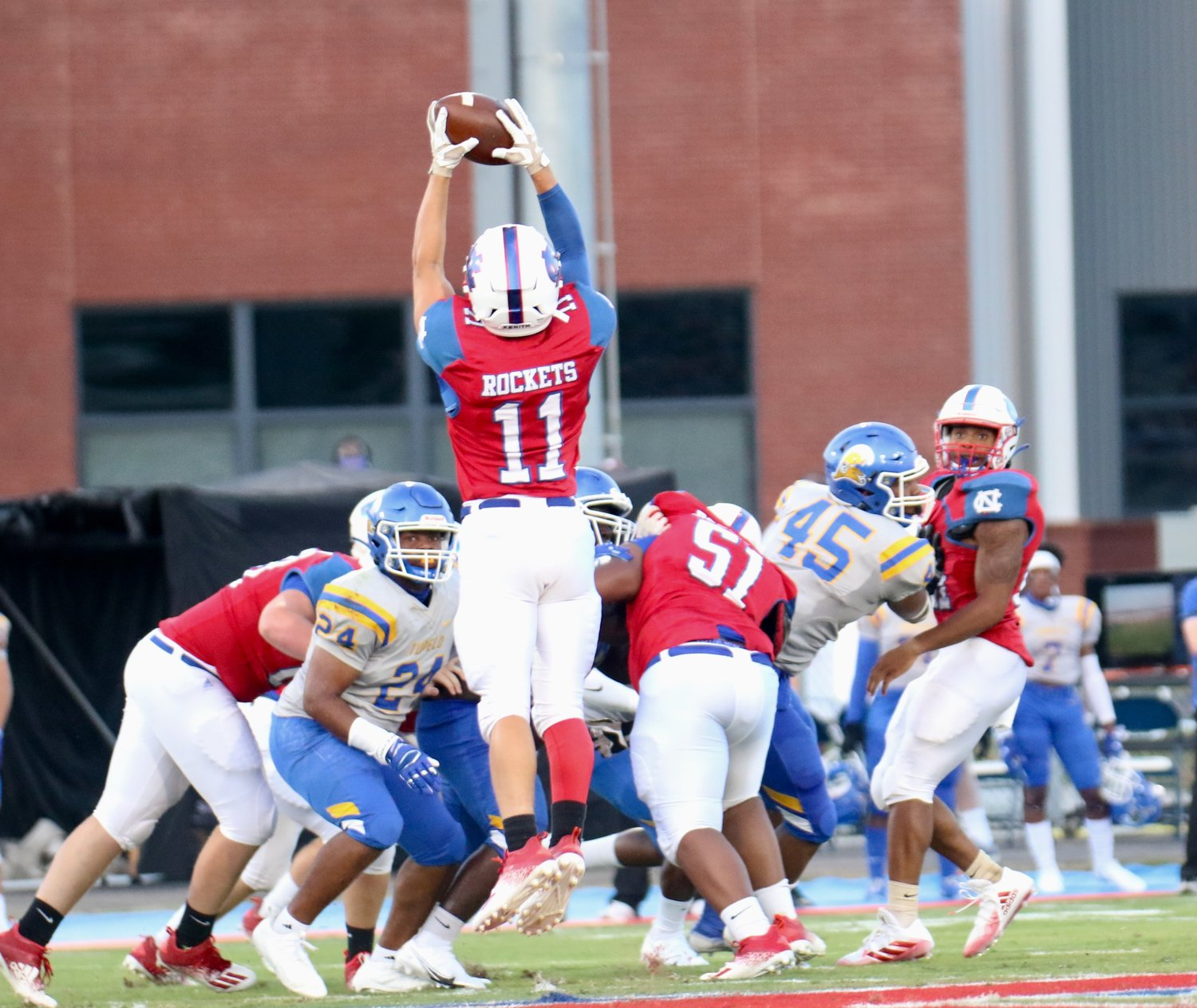 Neshoba Central's Dagan Martin (11) jumps up to receive a pass during the Rockets win over Tupelo.