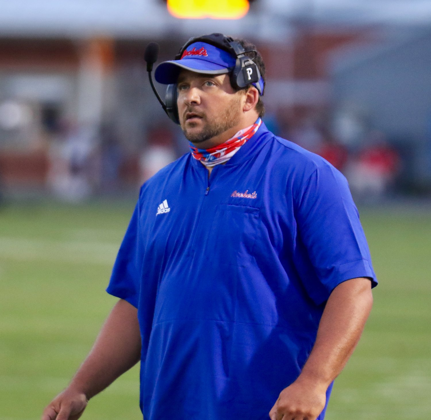 Rockets head coach Patrick Schoolar looks at the scoreboard as seconds tick off in the Neshoba Central's win over Tupelo.