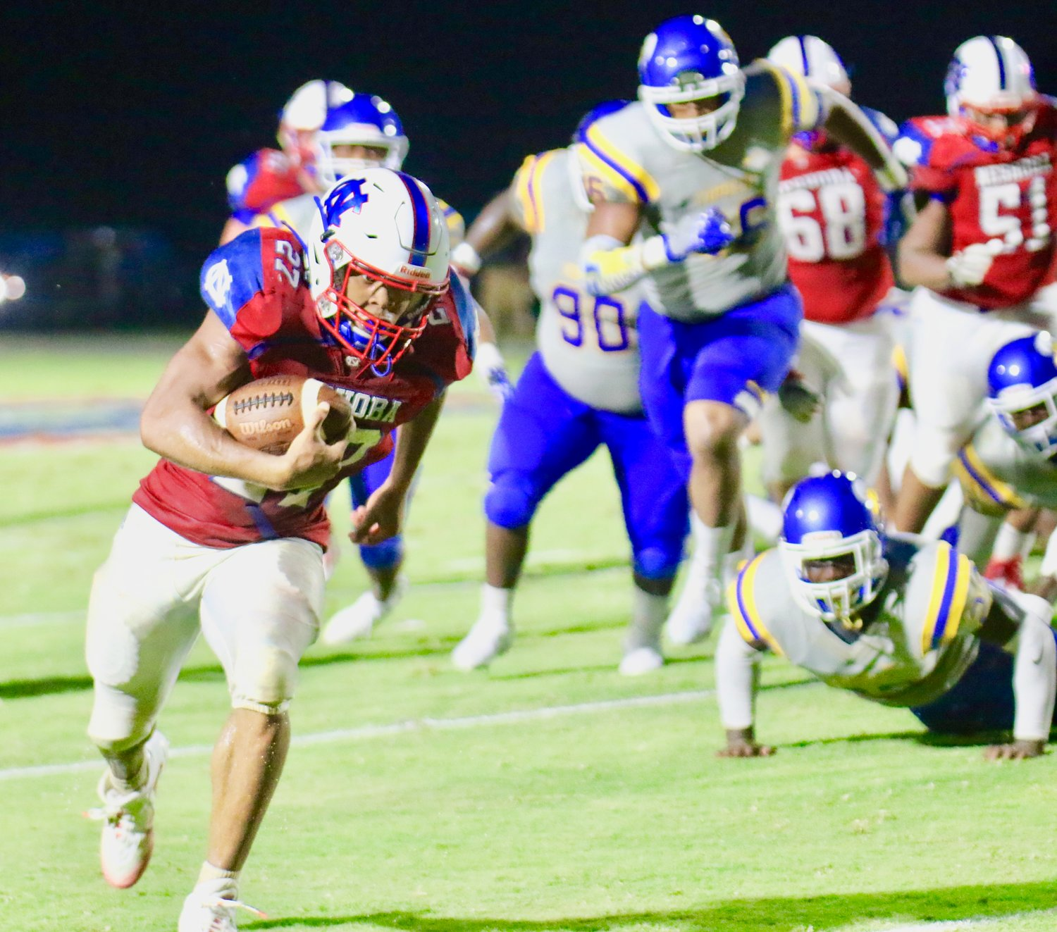 Jarquez Hunter (27) rushes 35 yards for a Rockets touchdown Friday night.