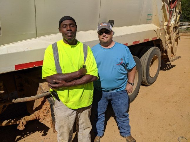 County sanitation workers Sid Whitehead and Tony McIntosh noticed a house on fire last Thursday on County Road 610. Their fast action saved the home.