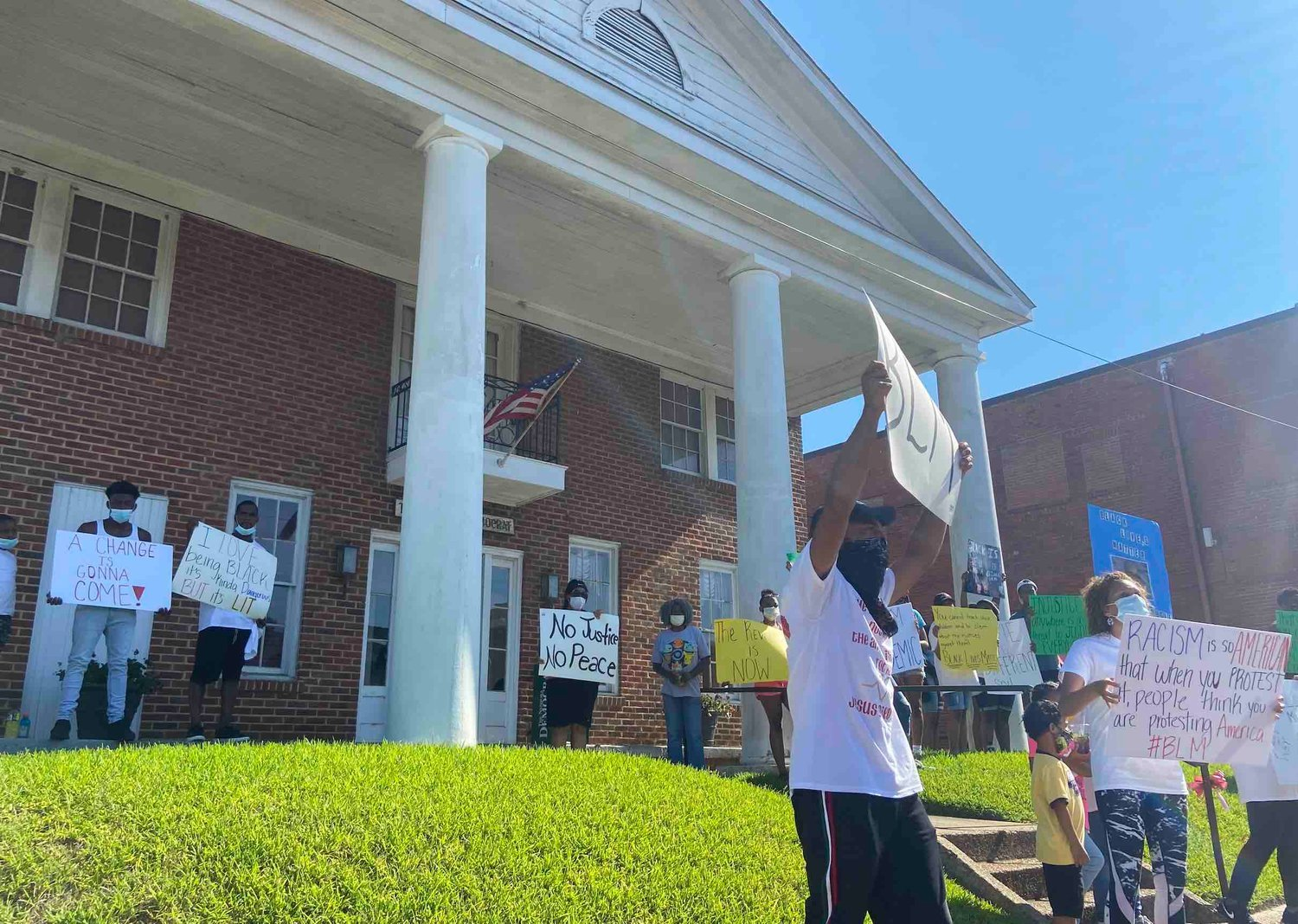 "As protestors headed to the courthouse in June, they stopped briefly in front of The Neshoba Democrat to call for ""no more bias in their (the Democrat's) coverage of our community."""