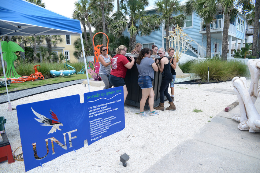A group of students in the UNF Sculpture Program get ready to install two new sculptures at the UNF Seaside Sculpture Park in Jacksonville Beach.
