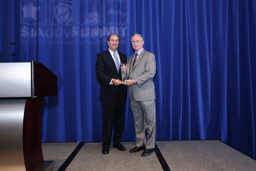 Congressman John Rutherford (right) receives the SIA Legislator of the Year Award for his work on the STOP School Violence Act following the Parkland shooting.