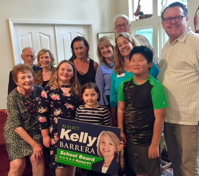 St. Johns County School Board District 4 Rep. Kelly Barrera attends a neighborhood meet and greet alongside Jackie Smith, Hank and Linda Lesane, Desire and Esme Boyer, Enoch Huang, Michelle, David and Greysen Smith and Joe Bryant. Barrera is one of three candidates in the School Board District 4 race.