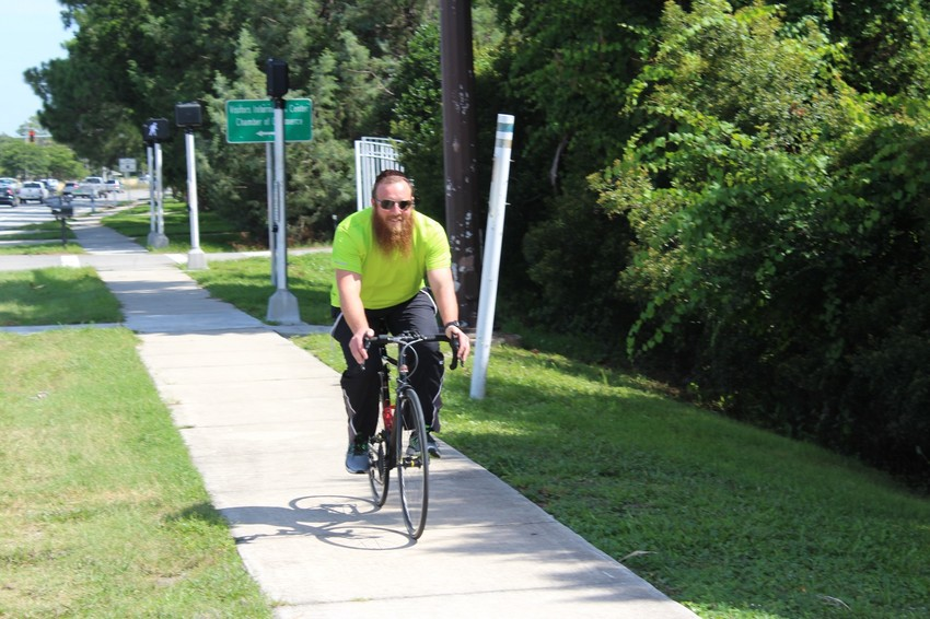 Chabad at the Beaches co-director Rabbi Nochum Kurinsky rides his bike along A1A. The rabbi recently embarked on a 600-mile journey from Ponte Vedra to Key West one year after suffering a heart attack.